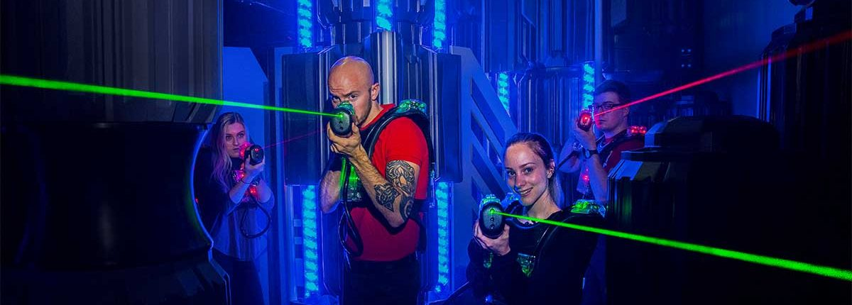 team building group playing laser tag