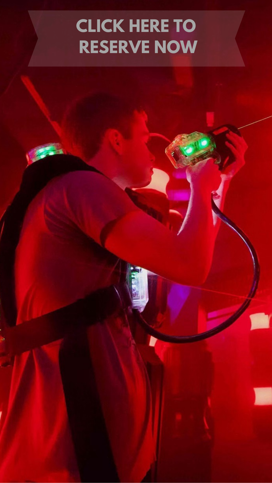 Laser tag player with red hue